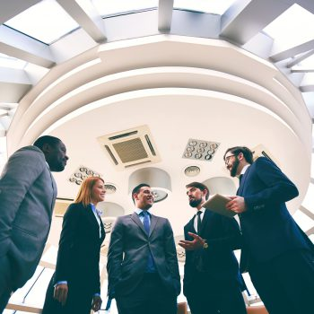 Business people communicating in board room